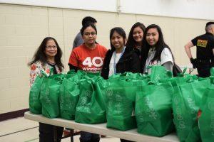 volunteers prepare bags for refugees