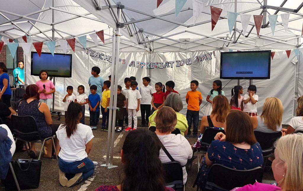 children performing for teachers