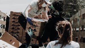 Volunteers unloading boxes of produce